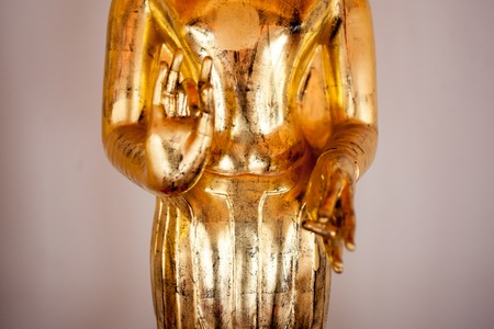 figuring: Gold figure of Buddha in temple in Bangkok, Thailand. Close-up