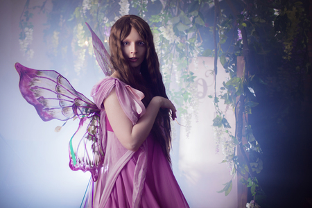 believe: Young beautiful woman in the image of fairies, dark forest