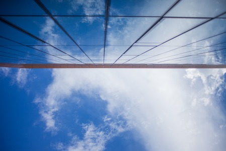 facade of glass office building, the view from the bottom up Stock Photo