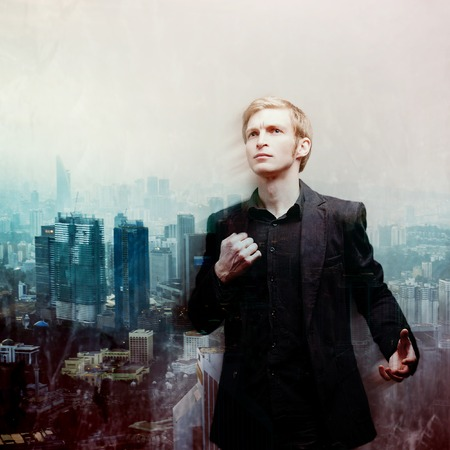 ambitious: ambitious young man on a background of megalopolis, double exposure