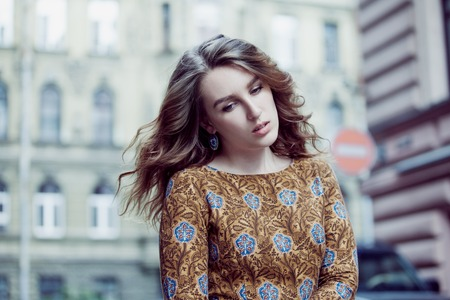 Portrait of young beautiful girl walking on the city center Stock Photo