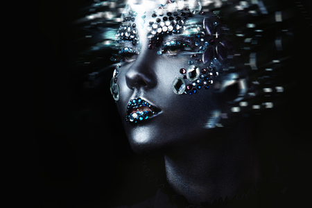 Young beautiful girl in black makeup with rhinestone, motion effect 免版税图像