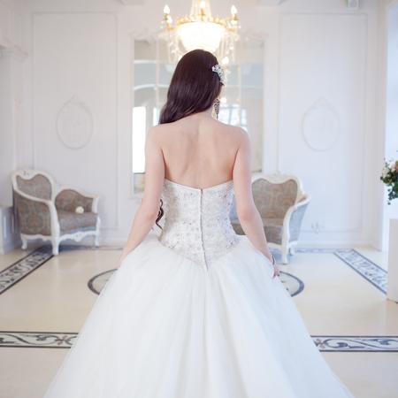 Portrait of beautiful bride. Wedding dress with open back. Wedding decoration Фото со стока