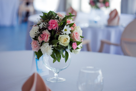 floristry: Wedding floristry. Beautiful lush bouquet on the table in the restaurant Stock Photo