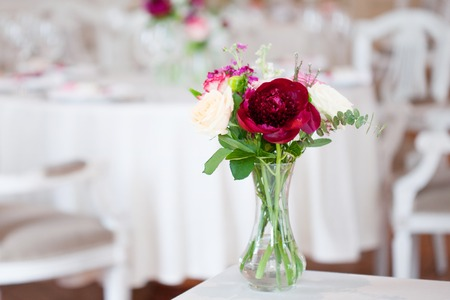 Wedding banquet, small restaurant floral, decor in red, informal style. Details close up Stock Photo