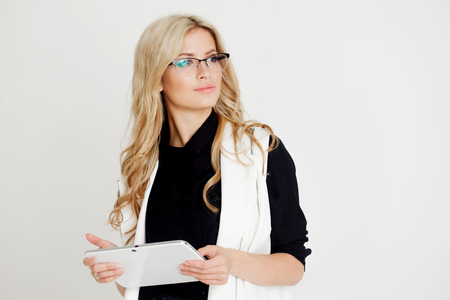 Portrait of young confident business lady, use the tablet, white background