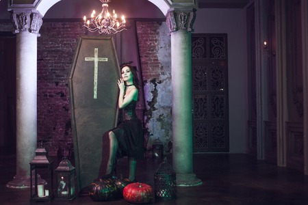 Beautiful and sexy vampire in her mansion. Halloween costume Stock Photo