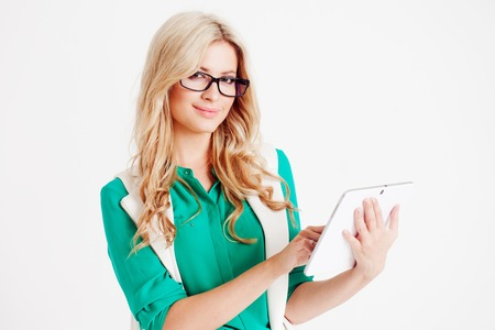 Portrait of young confident business lady, use the tablet looking on you