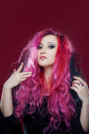 kinky: Attractive woman with pink hair in witch image. Halloween style, pin-up