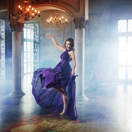 purple dress: Beauty Brunette model woman in evening purple dress.