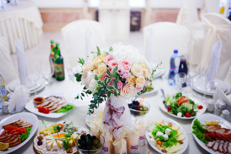 Serving wedding table flowers. Bureau for newlyweds