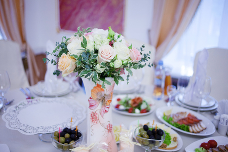 floristry: Wedding floristry. Beautiful lush bouquet on the table