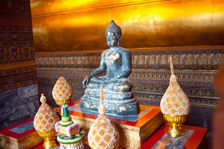 Gold figure of Buddha in temple in Bangkok, Thailand. Close-up