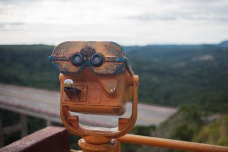 Coin Operated Binocular viewer next to the waterside promenade Stock Photo
