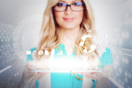 geolocation: Sharing and connection. Attractive woman holding a tablet, concept of the www and social media Stock Photo