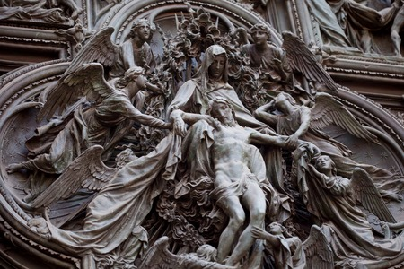 withdrawal: Detail of the Pieta scene in bas-relief at Milans Cathedral doors