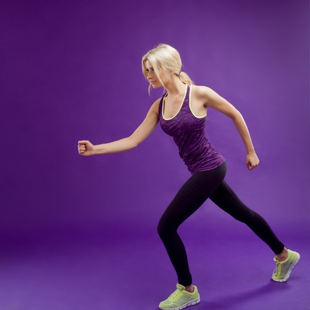 beautiful young girl in a pose runner, Studio background, purple