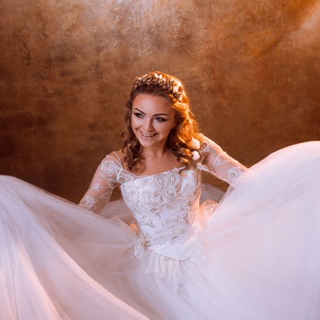 luxurious: Beautiful girl bride in a luxurious wedding dress, portrait in Golden tones, the effects of glare