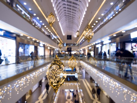 festively: Time of a Christmas sales, shopping center, festively decorated. blurred background Stock Photo