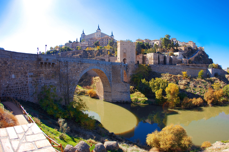 mancha: Alcantara bridge in Toledo with Alcazar on the background. Toledo, Castilla - La Mancha, Spain.