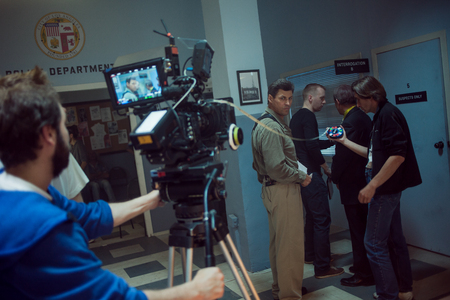 SAINT PETERSBURG, RUSSIA - AUGUST 20, 2016: Film Crew On Location. 4K Camera & Cinematographer. Filmmaking. Set, scenery police station