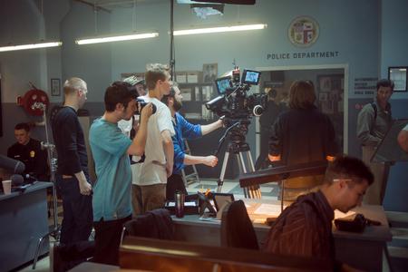 filmmaker: SAINT PETERSBURG, RUSSIA - AUGUST 20, 2016: Film Crew On Location. 4K Camera & Cinematographer. Filmmaking. Set, scenery police station