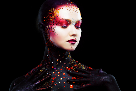 Young attractive blonde girl in a bright art-makeup, body painting.