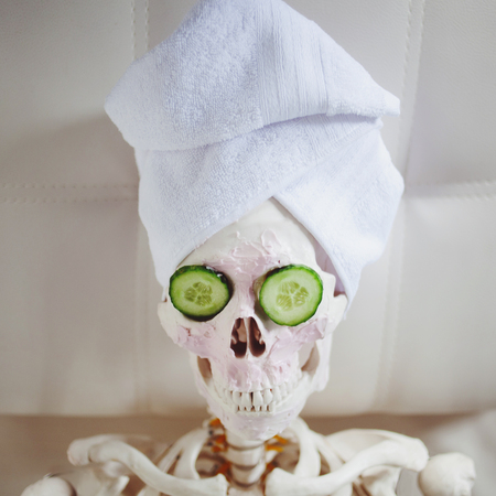 dead man to take care of beauty. Skeleton in Spa salon. Stock Photo