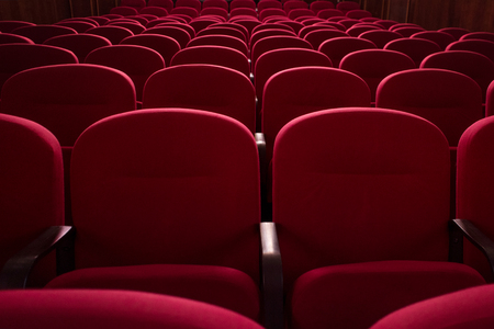 Empty cinema hall. Rows of red chairs. The crisis in film distribution Stock Photo