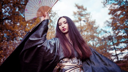 Dancing young woman in kimono, Asian costume