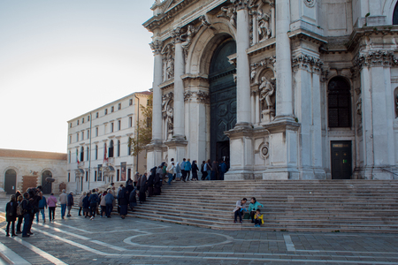 VENICE, ITALY - OCTOBER 7 , 2017: Parishioners go to Church, morning prayer. Cathedral of Santa Maria della Salute