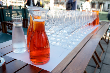 Aperol cocktail in a bottle at restaurant on the street