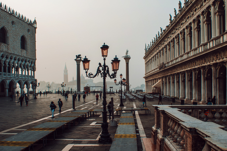 Venice, view of Piazza San Marco, a lot of tourists, fog Stock Photo