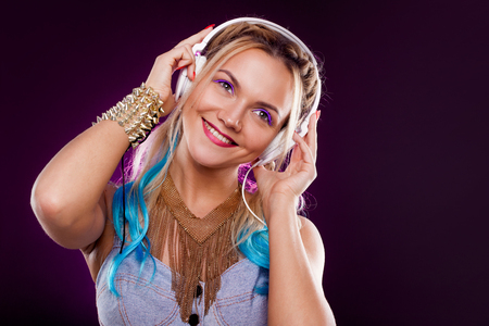 Young fashionable girl in disco style. Listening music and enjoying. Retro style Stock Photo