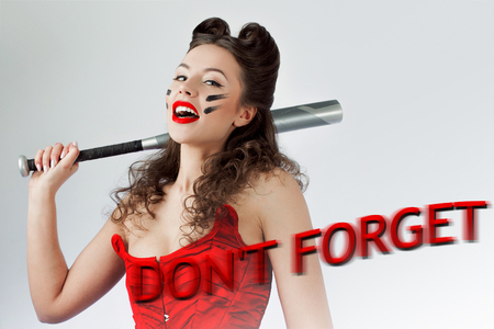 Dont forget Valentines day. Woman in red with a bat in war paint. Laughs and threatens