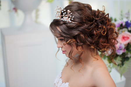 Portrait of a beautiful girl in a wedding dress. Bride in luxurious dress, close-up Stock Photo