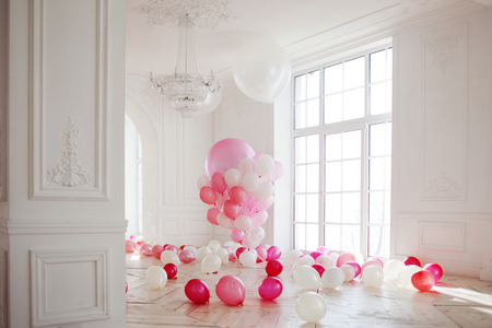 Luxurious living room with large window to the floor. The Palace is filled with pink balloons Banco de Imagens