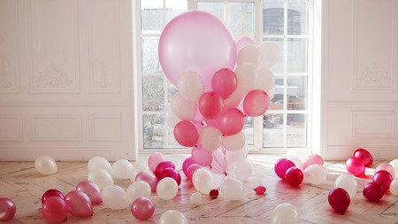 Luxurious living room with large window to the floor. The Palace is filled with pink balloons Stock Photo