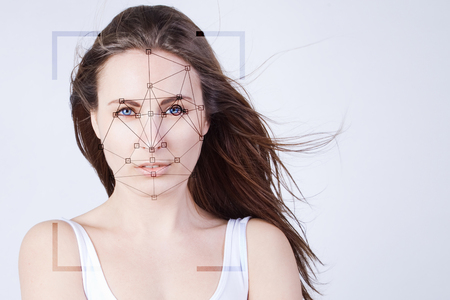 Facial recognition system, concept, young beautiful woman  with flyaway hair