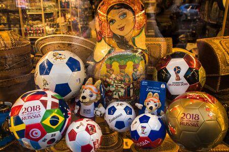 SAINT PETERSBURG, RUSSIA - JUNE 08, 2018: Souvenirs for world Cup. Shop window, soccer balls, Souvenirs, dolls