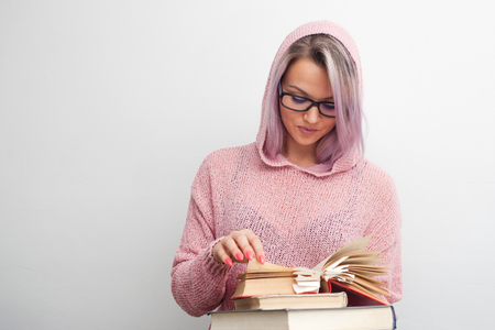 Student. Young woman with books. Girl a student makes research, get textbooks 版權商用圖片