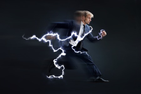 Fast business. Running businessman charged with lightning, concept. black background