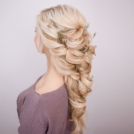 hairstyles with weaving strands decorated with small flowers. Blonde