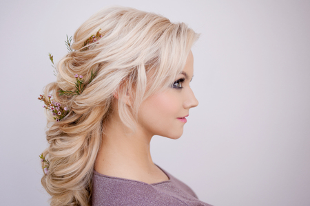 Portrait of an elegant young woman with blond hair. Trendy hairstyle, natural hair styling 版權商用圖片