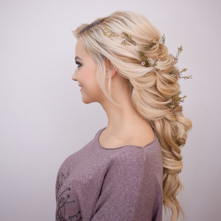 Portrait of an elegant young woman with blond hair. Trendy hairstyle, natural hair styling Stock Photo