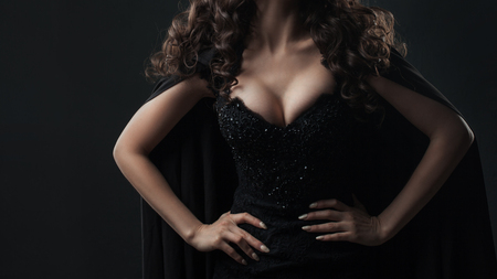 Attractive woman with beautiful Breasts, sexy portrait on black background, body parts Stock Photo