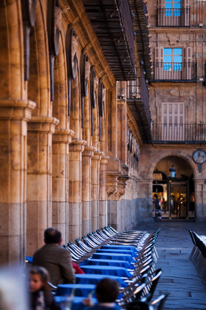street cafe in Salamanca, Spain. Classical colonnade on the old town square, architectural attractions. Spanish and Moorish architecture