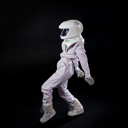 Running Astronaut in space, in zero gravity on black background. 写真素材