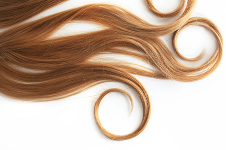 Blonde Curls hair isolated on white background. Strand of light or red hair, hair care, concept Stock Photo