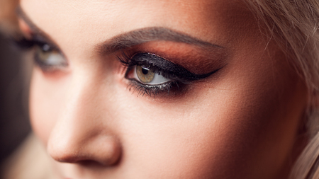Female eye with evening makeup, close-up. Bright makeup, eye shadow and lashes